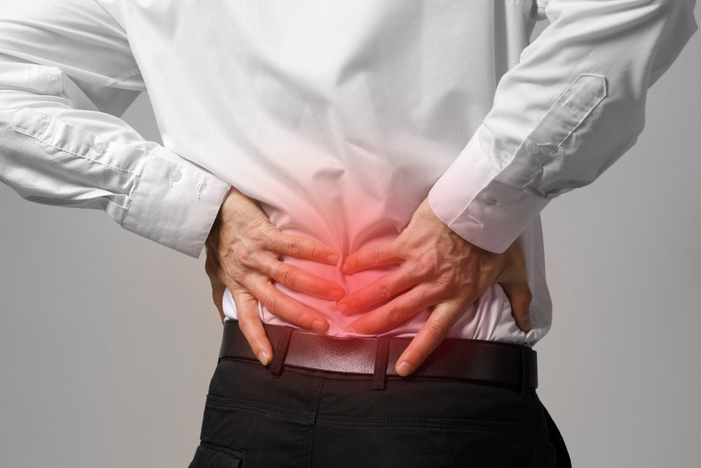Can Back Problems Cause Stomach Pain?